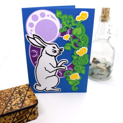 Moonlight Rabbit Greetings Card, layered paper cut design, front view.