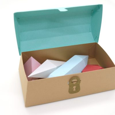 Treasure Chest in aqua and tan, open to demonstrate presentation.