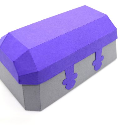 Treasure Chest in purple and grey, from behind.