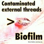 Contaminated externally threaded barbell detail
