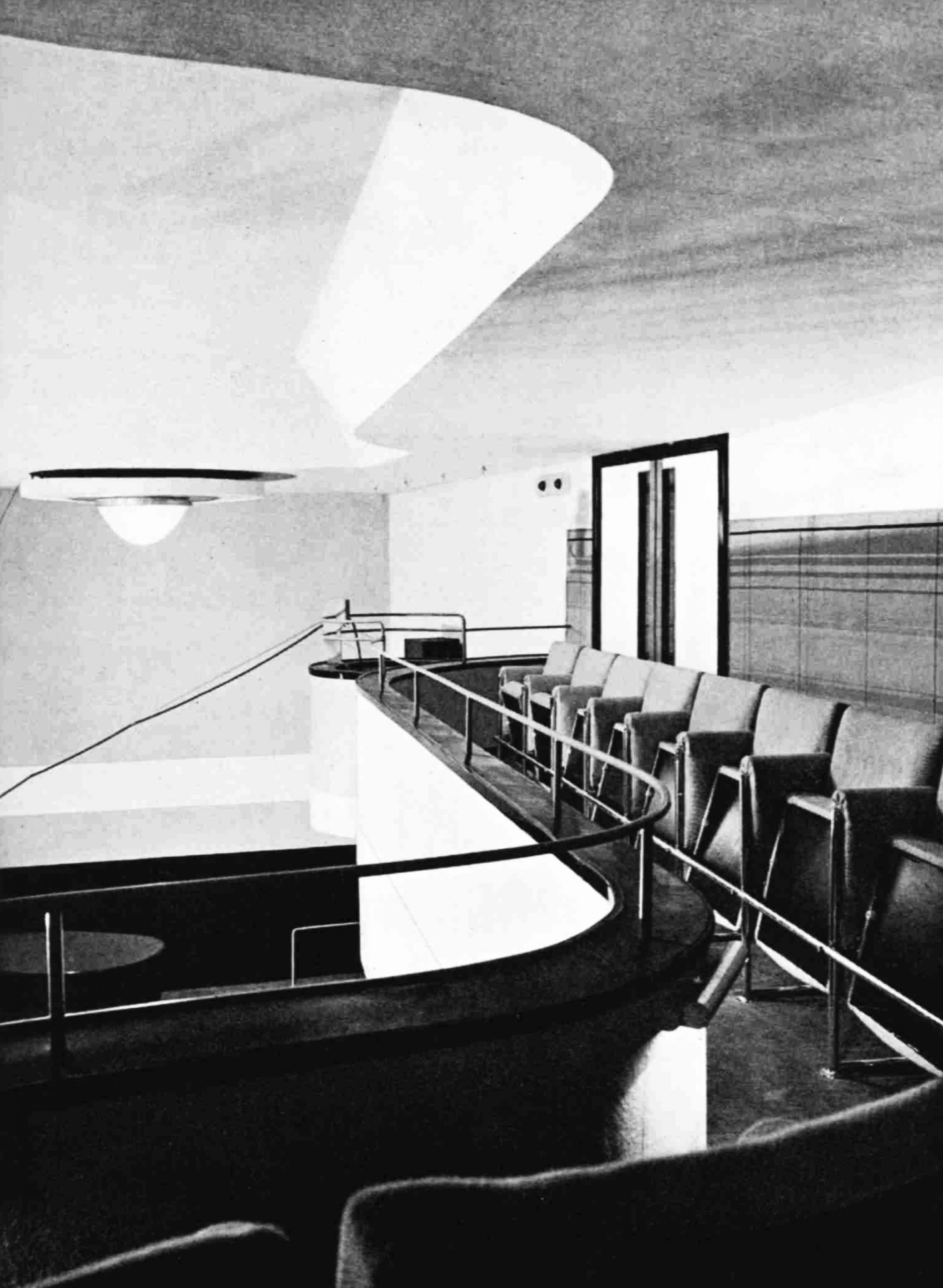A curved balcony with seats