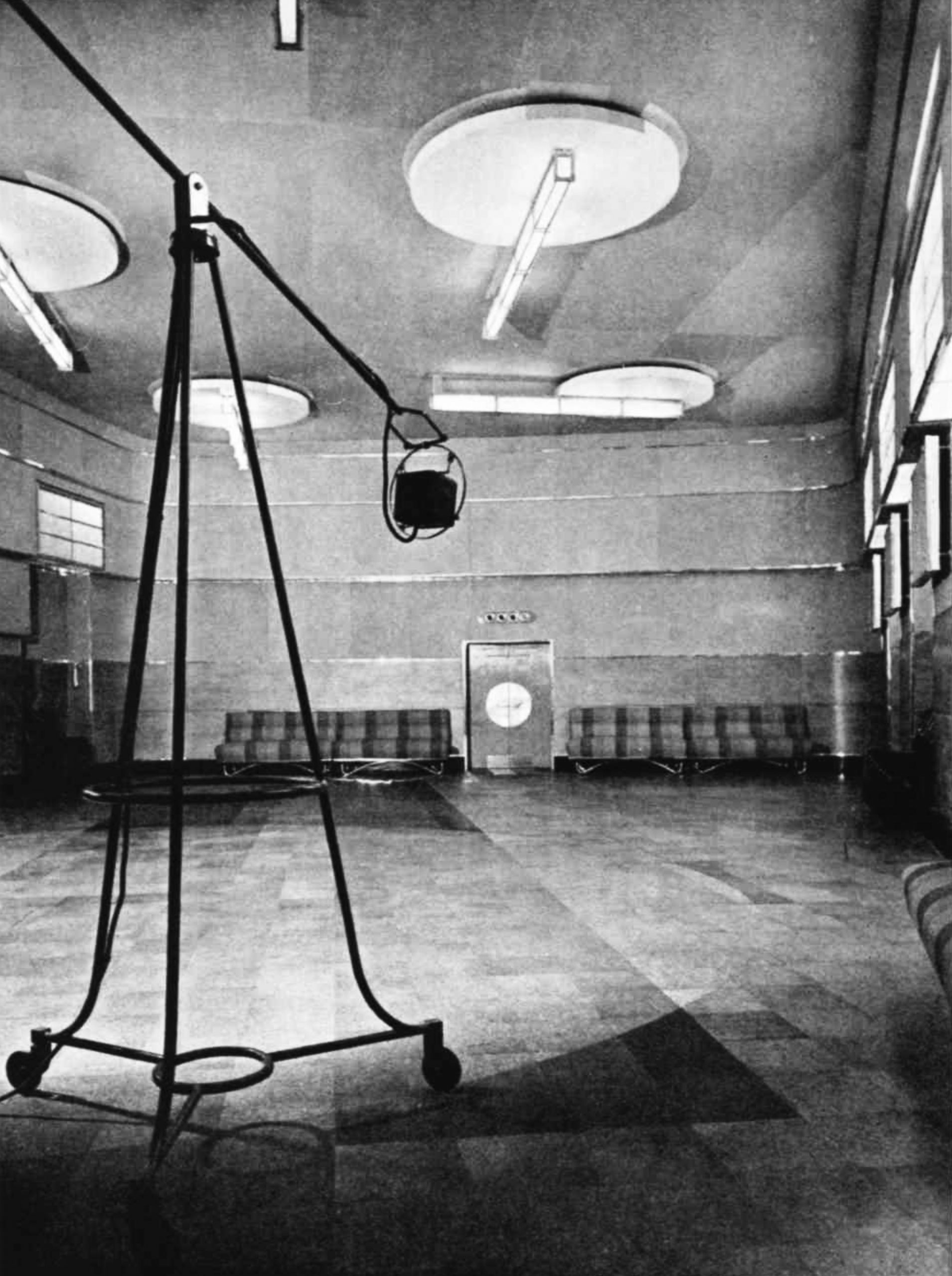 A microphone on a portable stand in the midst of a large empty space