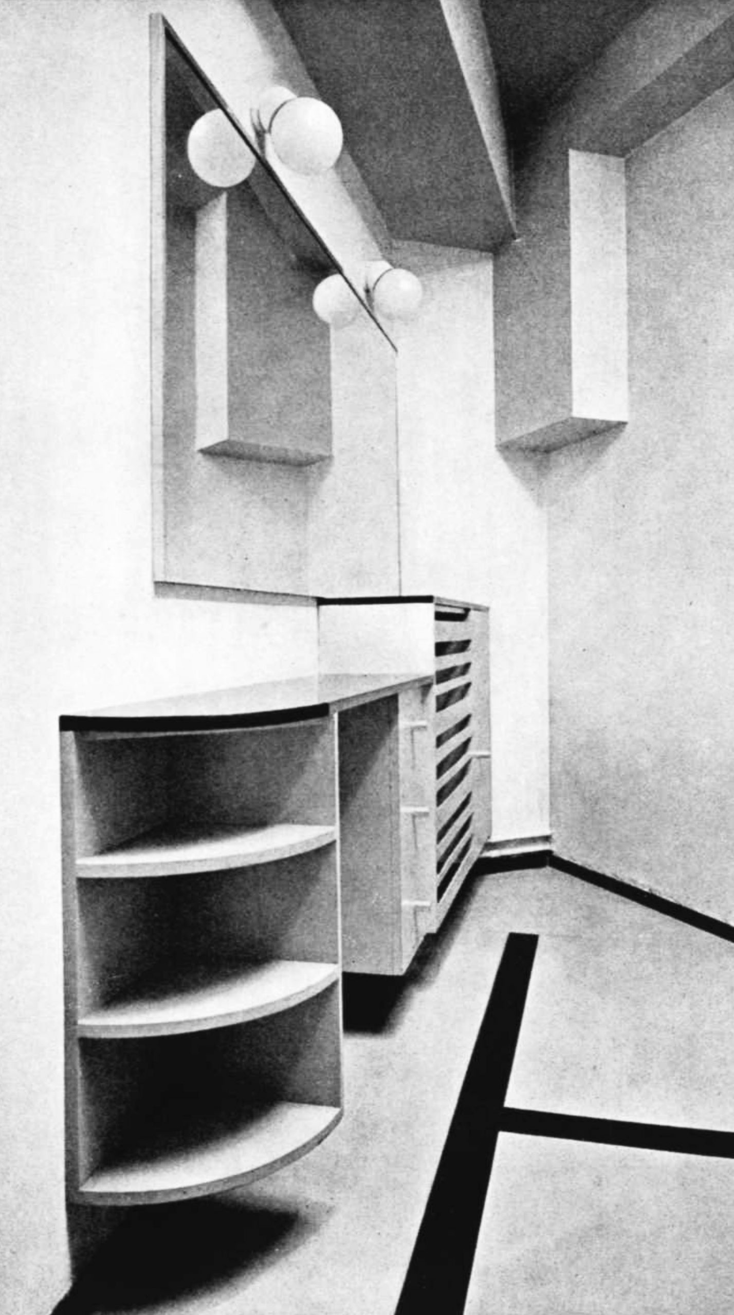 A small room with shelves, drawers, cupboards and a large illuminated mirror