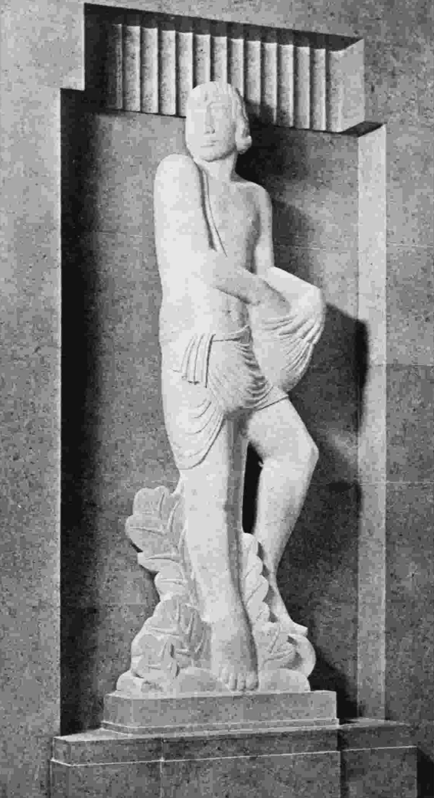 A stylised statue of a man sowing by broadcast