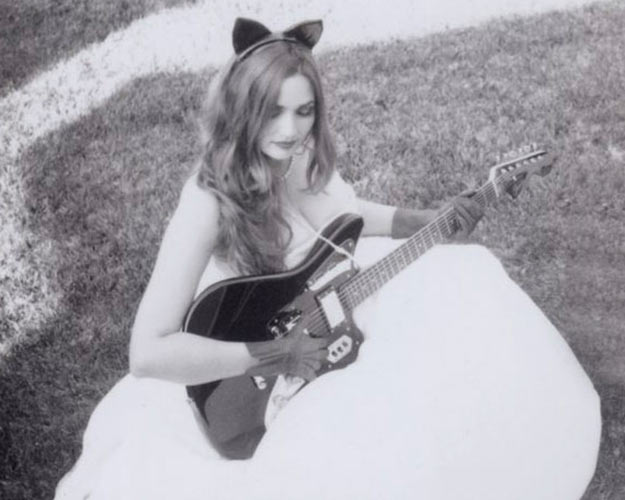 Sarah Eakins with guitar - earlier band promo photo