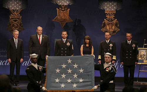 160301-N-ED767-004 WASHINGTON (March 1, 2016) Members of the U.S. Navy Ceremonial Guard display the Medal of Honor flag during a Hall of Heroes induction ceremony Tuesday, March 1, 2016 for Senior Chief Special Warfare Operator (SEAL) Edward C. Byers Jr. at the Pentagon Auditorium. From left, Secretary of the Navy Ray Mabus, Deputy Secretary of Defense Robert O. Work, Byers and his wife, Madison Byers, Chief of Naval Operations (CNO) John Richardson and Master Chief Petty Officer of the Navy (MCPON) Mike Stevens. Byers was awarded the Medal of Honor by President Barack Obama for his actions during a hostage rescue operation in Afghanistan in December 2012. (U.S. Navy photo by Oscar Sosa/Released) (U.S. Navy photo by Oscar Sosa/Released)
