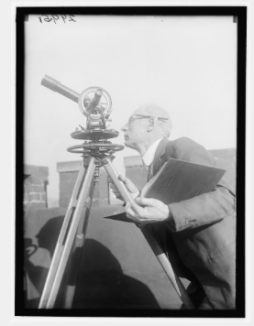 A man looking through a telescope