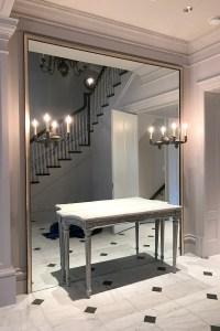 Wall sized foyer mirror installation