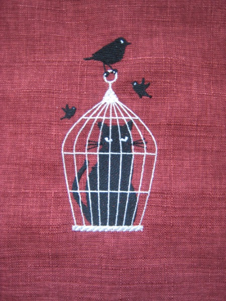 broderie chat dans cage