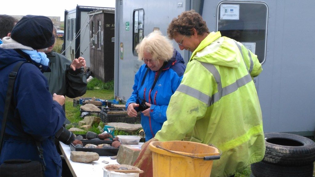 A busy day with lots of fun for Chris at his stone tools table. Ness of Brodgar Open Day, 20 August 2017.