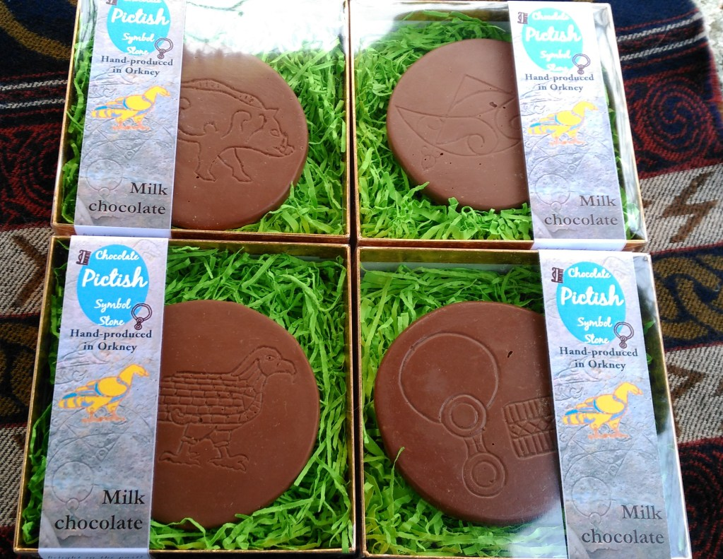 Pictish designs in Belgian milk chocolate. Boar, Eagle, Crescent & V-Rod, Comb & Mirror.
