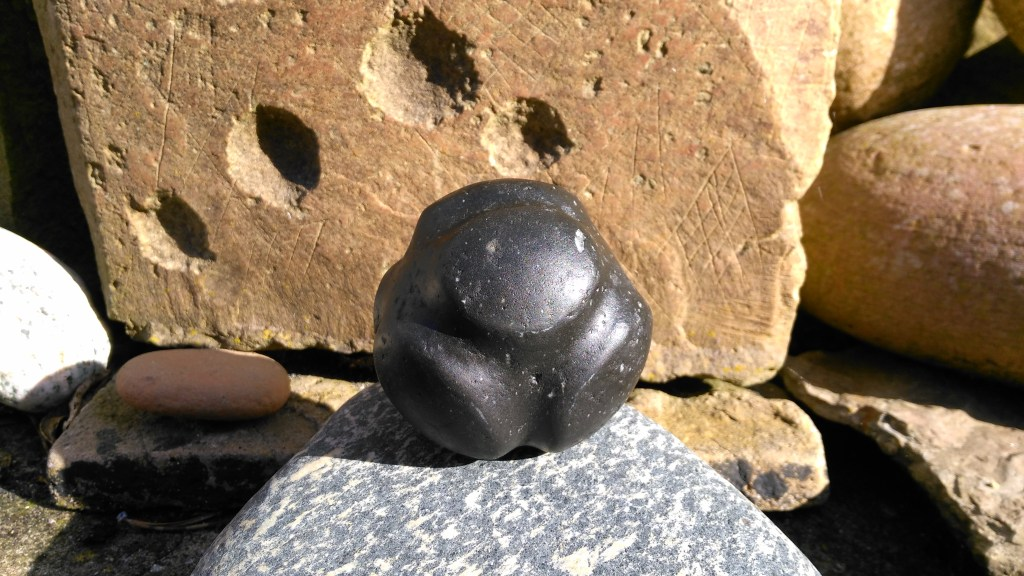 Carved stone ball by Chris Gee from Ness of Brodgar. This one was made on commission for a good friend, as a 25th wedding anniversary present.