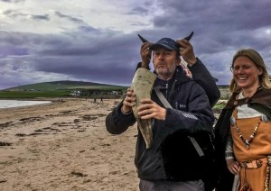 Playing with horns at Viking Feast on the Beach, Orkney