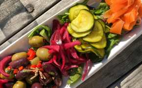 A tray of colourful sliced vegetable pickles