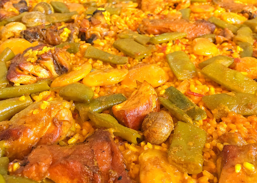 Chicken, rabbit, snails and green beans paella - Things to do in Valencia, Spain
