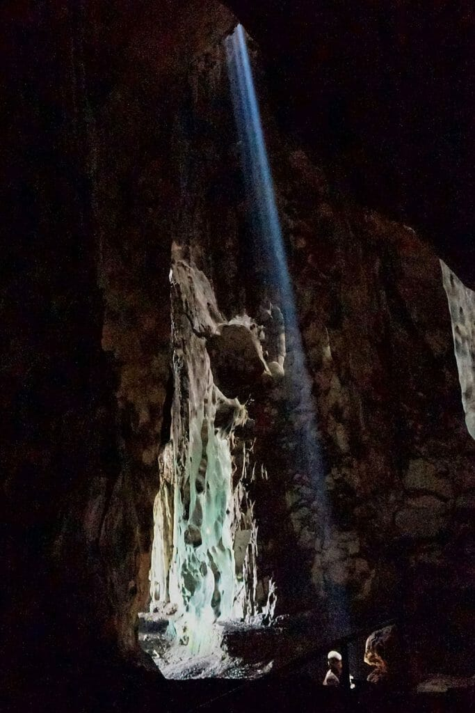 Ray of light shinning through a hole in the ceiling of a cave