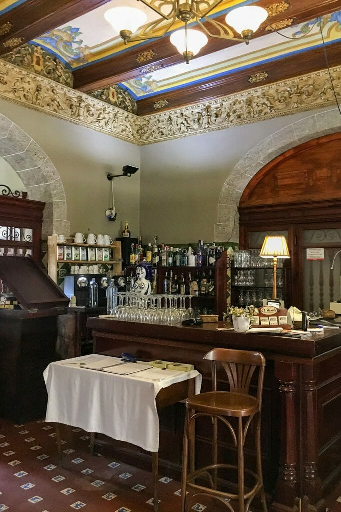 Traditional bar with chair, table and wine glasses on the counter in Valencia