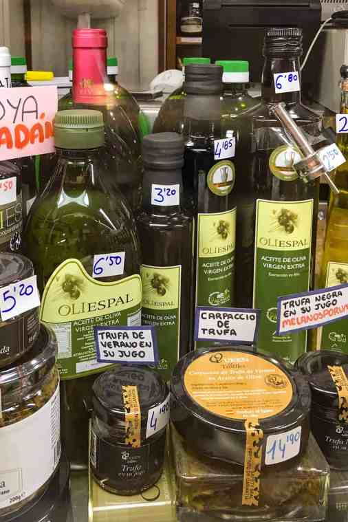 Bottles of olive oil with price tags