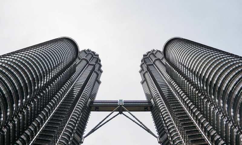 Symmetrical look up of Petronas Twin Towers with Sky Bridge joining them