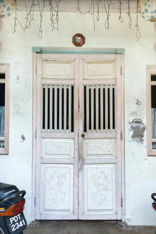 Chinese shophouse with pink wooden door