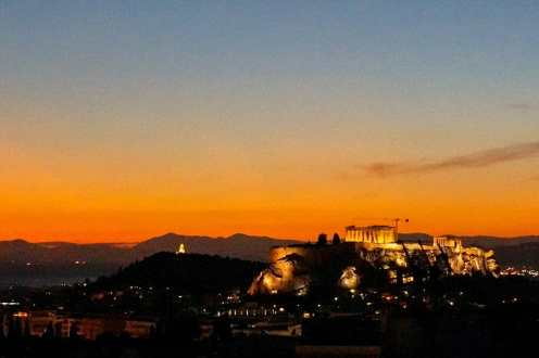 Sunset view of the Acropolis from the roof terrace of Coco-Mat Athens Boutique Hotel