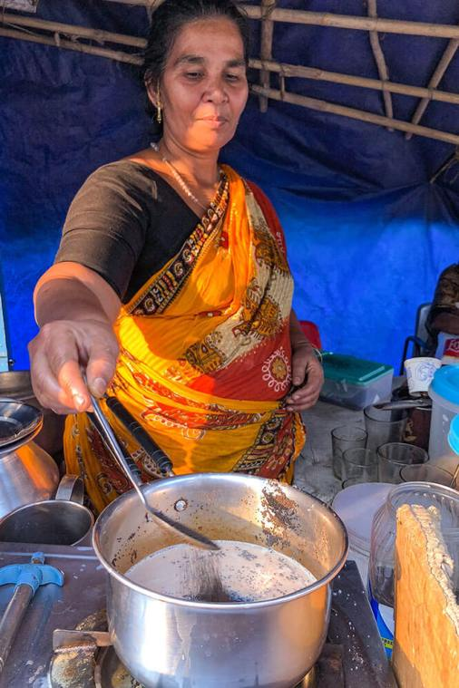 Lady making masala chai at a roadside chai stall in Munnar, Kerala - #munnar #kerala #india