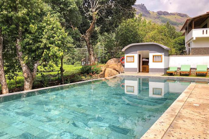 Infinity pool at Windermere Estate with views of tea plantation in Munnar, Kerala - #munnar #kerala #india