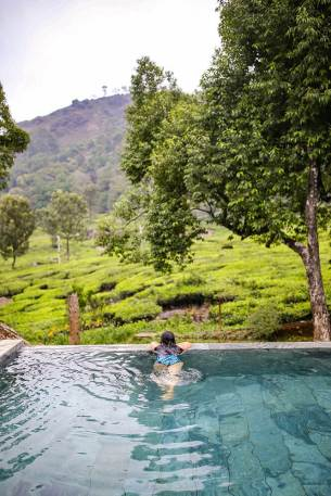 Enjoying the views of the tea plantation from the infinity pool at Windermere Estate in Munnar, Kerala - #munnar #kerala #india