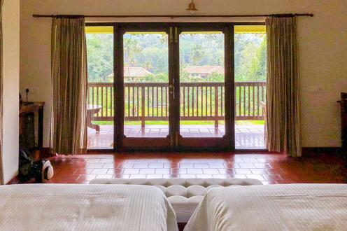 View of banana and palm trees form room at Windermere River House in Neriamangalam - #kerala #india