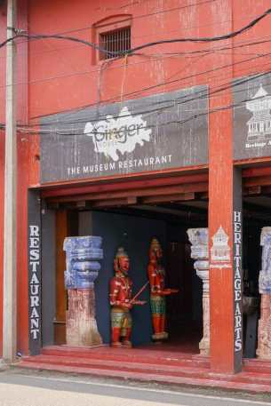 The entrance to Ginger House Cafe in Kochi is through an antique dealer