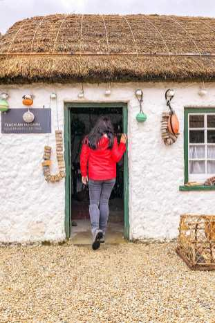 Standing at the door of the Fisherman's Cottage at the Glencolmcille Folk Village museum