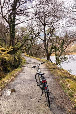 Bike parked on the bridleway with the lake on the right in Gleveagh National Park