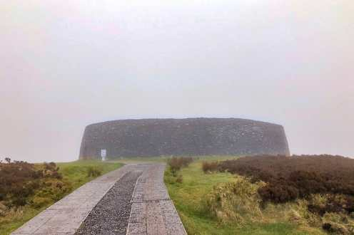 Stone hillfort from the approaching road with poor visibility due to misty weather