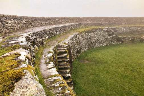 View from the top of the Grianan of Aileach stone circle, showing steps, in the rain