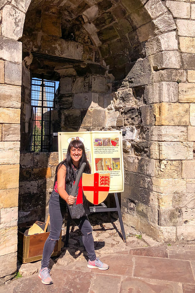 Dress like a knight with a plastic sworn and a wooden shield at Clifford's Tower