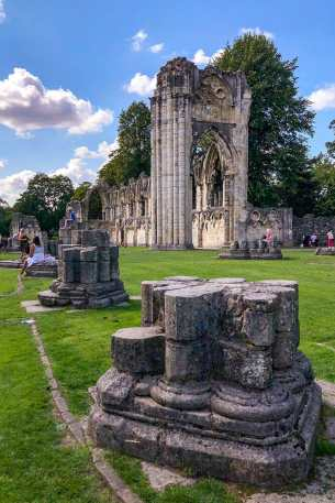 Ruins of St Mary's Abbey. Column bases and arch in the distance