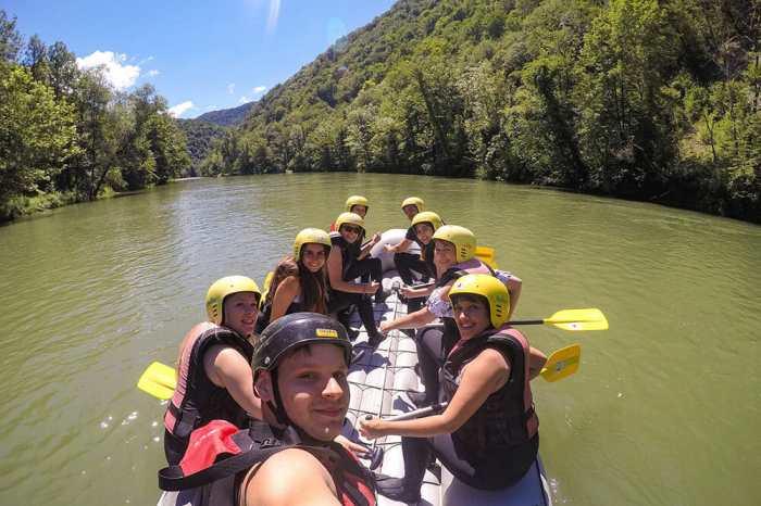Group shot of us rafting down the Kolpa river