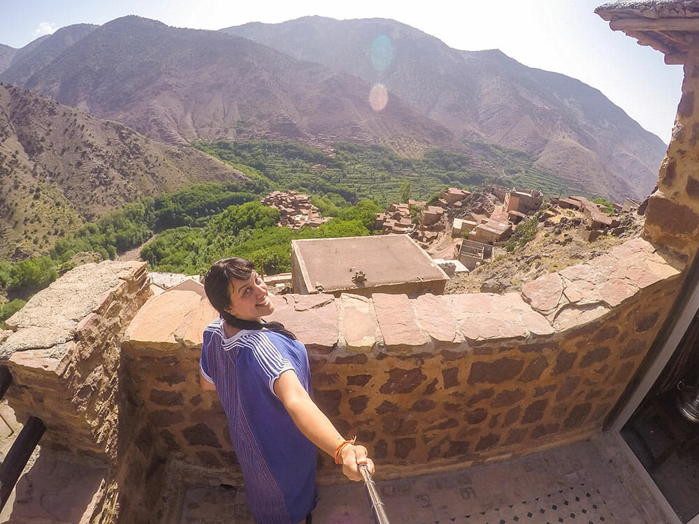 Taking a selfie from the Lodge terrace with the view of the village, the valley and the mountains