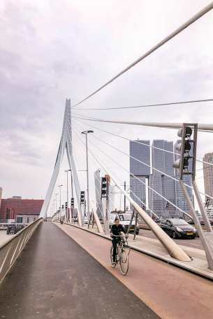 On a suspension bridge with a lady on a bike approaching