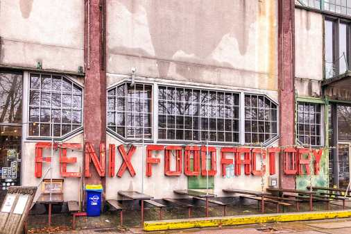 Shabby facade of an old warehouse with Fenix Food Factory sign