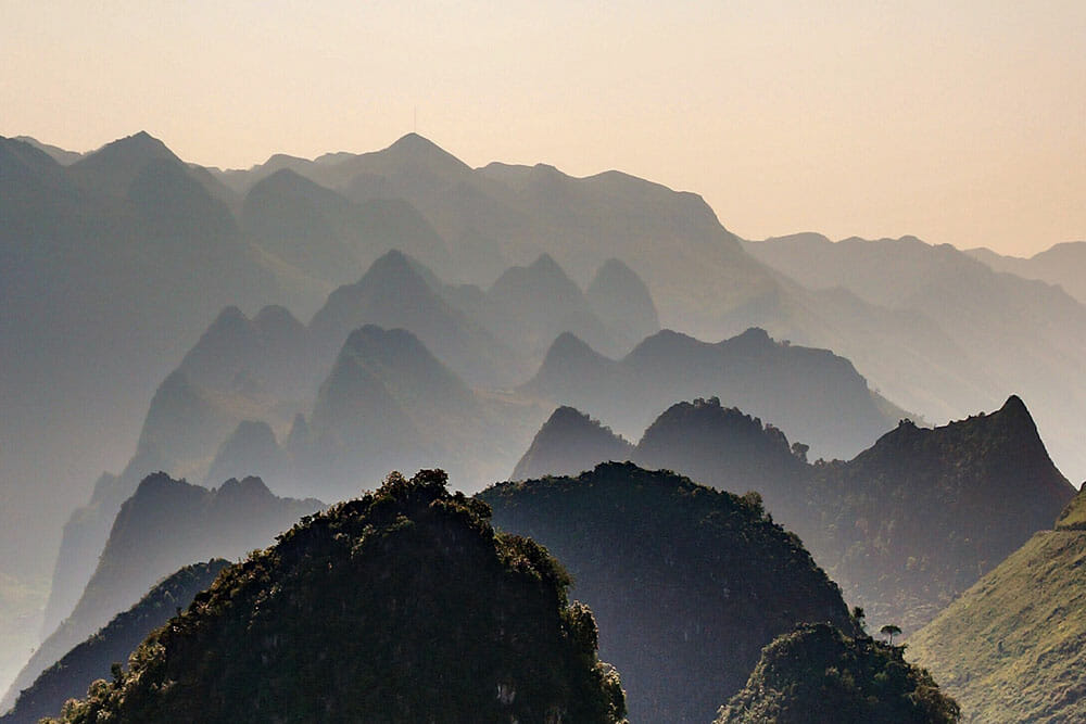 Layers of mountains in the morning mist in Ha Giang, Vietnam, one of my personal seven wonders