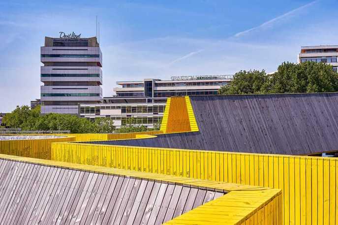 Yellow wooden bridge zig zagging away