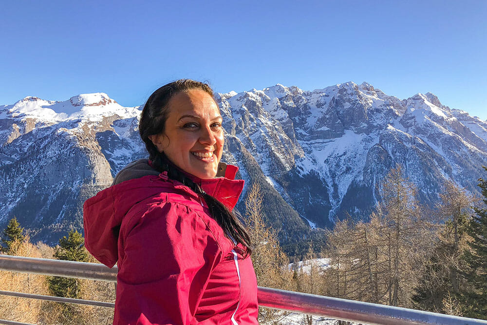 Standing at a view point with snowy mountains in the background
