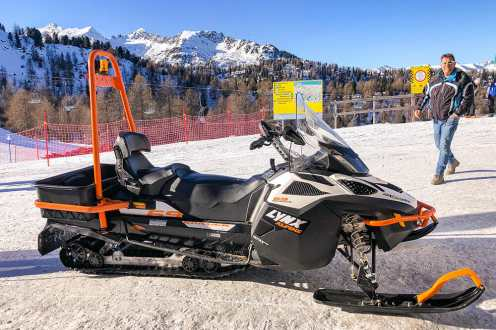 A snowmobile parked in the snow
