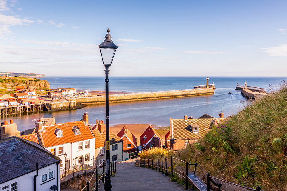 Whitby is a great day trip from York. Cute street going down into the harbour with street lamp