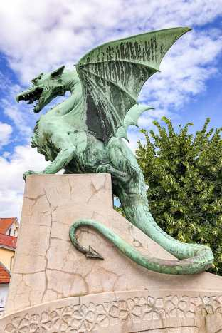 Statue of a dragon on a plynth
