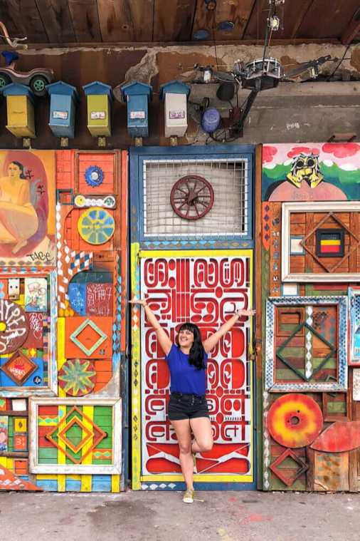 Standing in front of a creatively decorated colourful facade