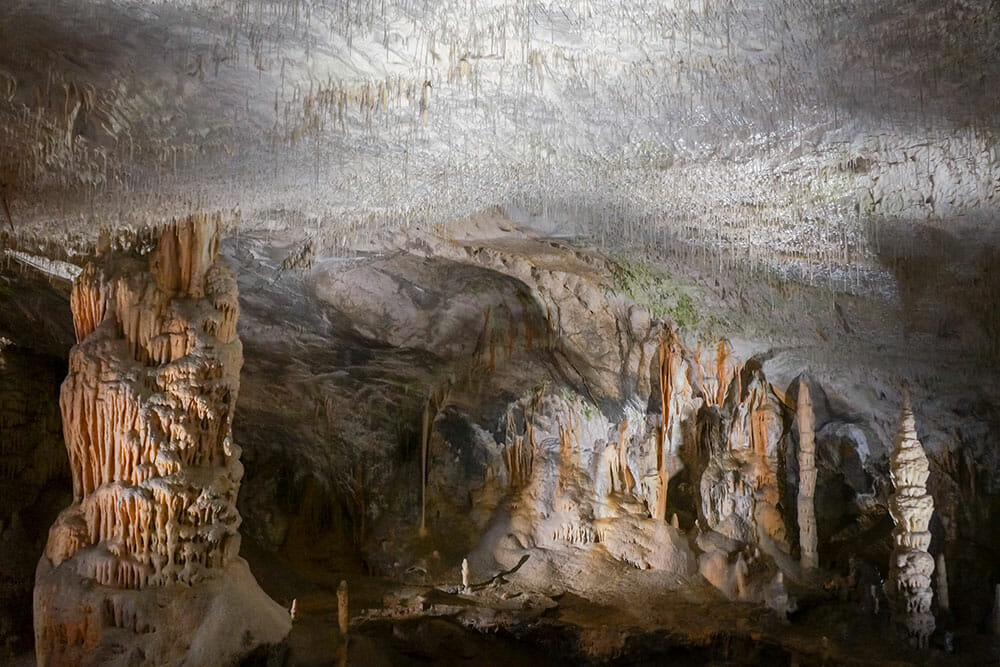 Cave with spaghetti stalactites coming from the ceiling