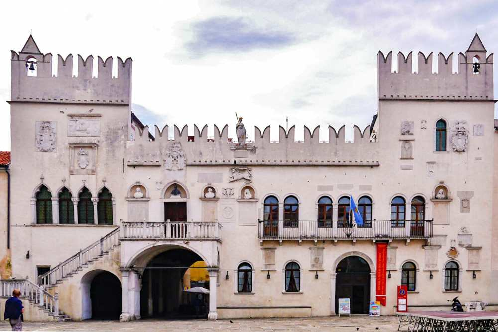 Facade of a castle with double turrets