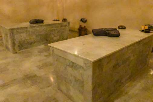 Two white marble platforms in a hammam room
